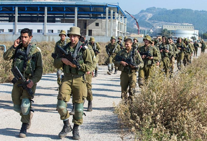 Israeli soldiers patrol the northern Israeli-Lebanon border on December 21, 2015