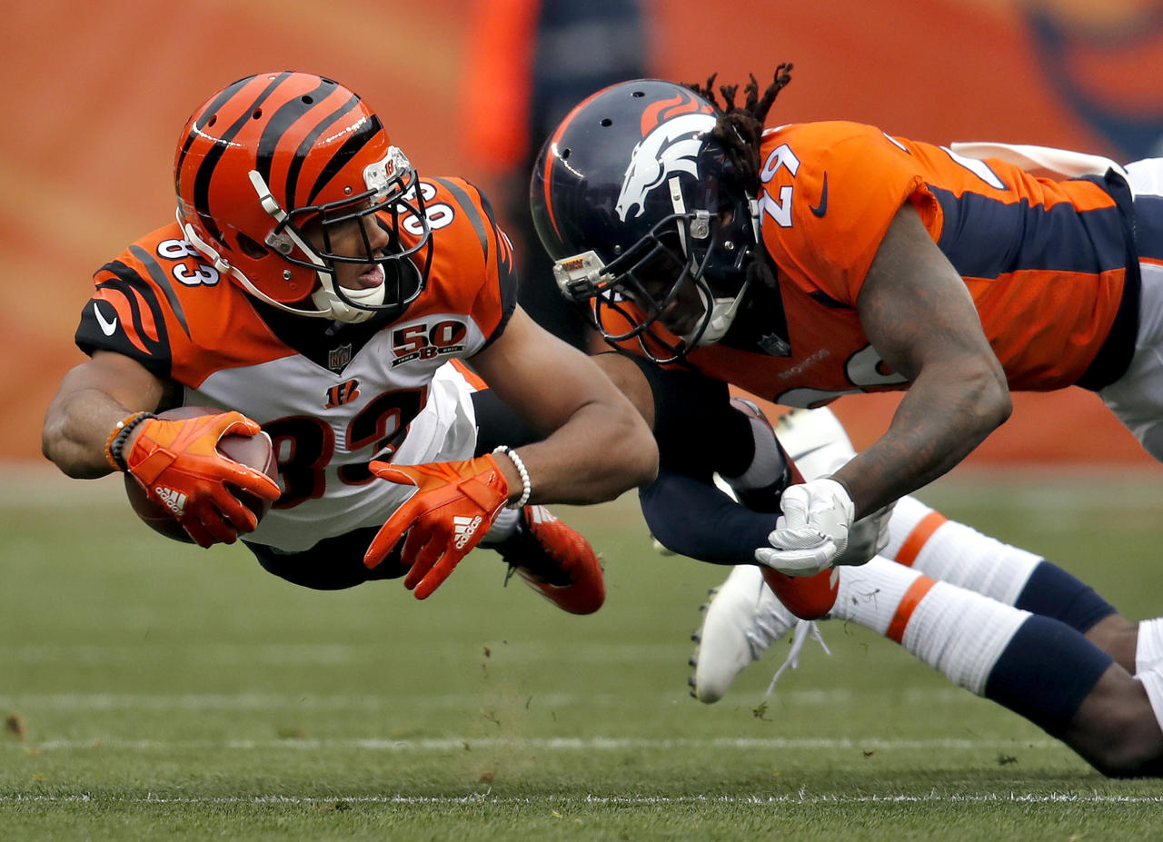 <p>Cincinnati Bengals wide receiver Tyler Boyd (83) lunges for yards as Denver Broncos free safety Bradley Roby (29) makes the hit during the first half of an NFL football game, Sunday, Nov. 19, 2017, in Denver. (AP Photo/David Zalubowski) </p>