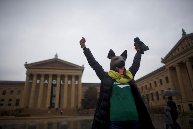 A person wears an underdog mask outside the Philadelphia Art Museum, before the Super Bowl LII game between the Philadelphia Eagles and New England Patriots, in Philadelphia, Pennsylvania, U.S., February 4, 2018. REUTERS/Mark Makela