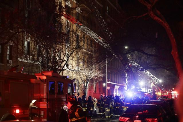 <p>Firefighters respond to a building fire Thursday, Dec. 28, 2017, in the Bronx borough of New York. The Fire Department of New York says a blaze raging in the Bronx apartment building has seriously injured more than a dozen of people. (Photo: Frank Franklin II/AP) </p>