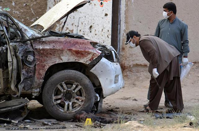 <p>Security officers collect evidence as they investigate crime scene after a bomb exploded next to a convoy of deputy chairman of the Pakistan Senate, Senator Ghafoor Haideri in Mastung, Pakistan, May 12, 2017. (Photo: Naseer Ahmed/Reuters) </p>