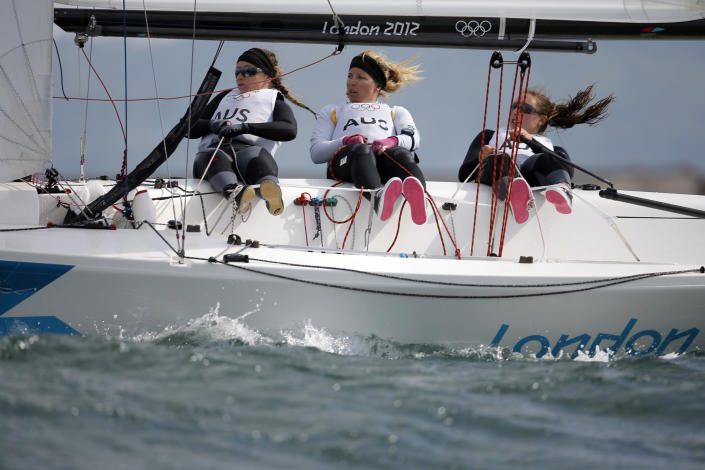 FILE - In this Aug. 11, 2012, file photo, Australia's Elliot 6m crew Lucinda Whitty, left, Nina Curtis and Olivia Price compete during the medal race at the Summer Olympics, in Weymouth and Portland, England. Curtis has been picked to join the defending champion Australian SailGP team for the rest of the season as part of a developmental program designed to bring women into the global league. Curtis, who won a silver medal at the 2012 London Olympics and sailed with Team Brunel on the final five legs of the 2017-18 Volvo Ocean Race, beat out Lisa Darmanin in a training camp during the season-opening regatta in Bermuda two weeks ago. (AP Photo/Francois Mori, File)