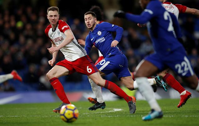 "Soccer Football - Premier League - Chelsea vs West Bromwich Albion - Stamford Bridge, London, Britain - February 12, 2018 Chelsea's Eden Hazard in action with West Bromwich Albion's Jonny Evans REUTERS/Eddie Keogh EDITORIAL USE ONLY. No use with unauthorized audio, video, data, fixture lists, club/league logos or ""live"" services. Online in-match use limited to 75 images, no video emulation. No use in betting, games or single club/league/player publications. Please contact your account representative for further details."