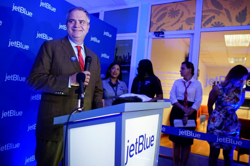 JetBlue's chief executive Robin Hayes speaks during the opening of a JetBlue ticket office in Havana, Cuba