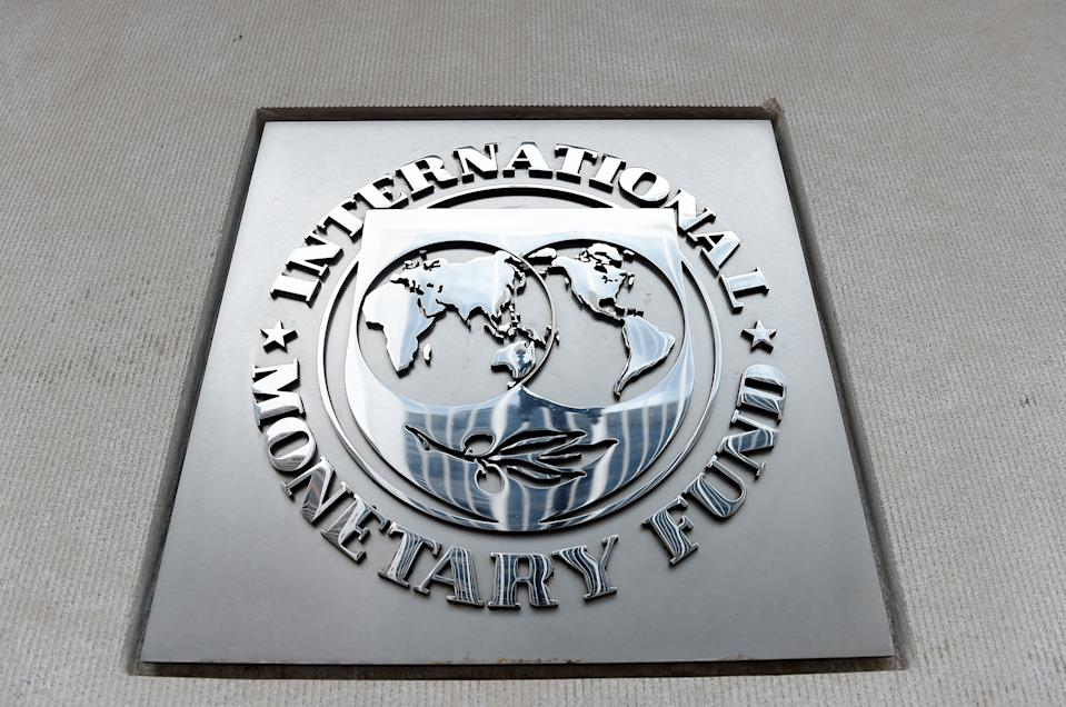 An exterior view of the building of the International Monetary Fund (IMF), with the IMG logo, is seen on March 27, 2020 in Washington, DC. - The coronavirus pandemic has driven the global economy into a downturn that will require massive funding to help developing nations, IMF chief Kristalina Georgieva said on March 27, 2020. Photo: OLIVIER DOULIERY/AFP via Getty Images