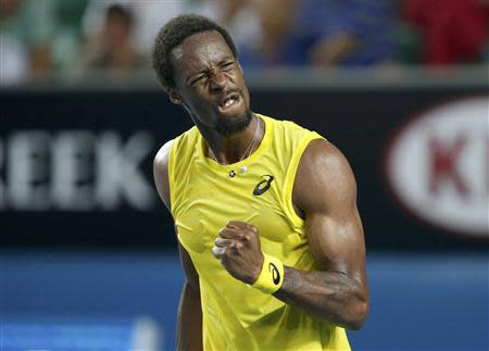 Gael Monfils of France celebrates a point during his men's singles match against Ryan Harrison of the United States at the Australian Open 2014 tennis tournament in Melbourne January 14, 2014. REUTERS/Bobby Yip