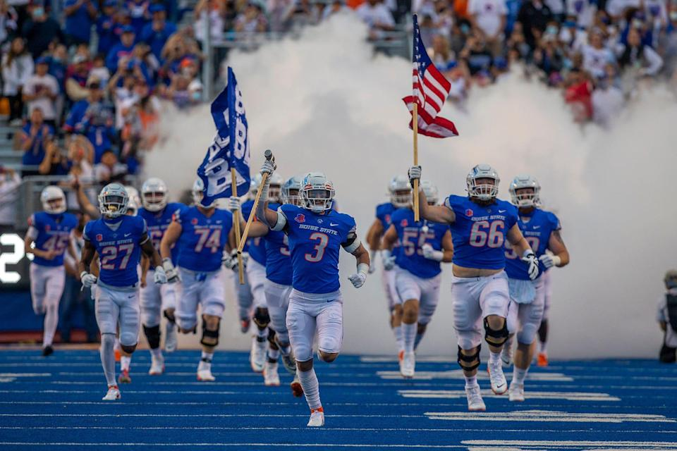Boise State Broncos bring the American flag onto the field prior to the game against the UTEP Miners at Albertsons Stadium on Sept. 10.