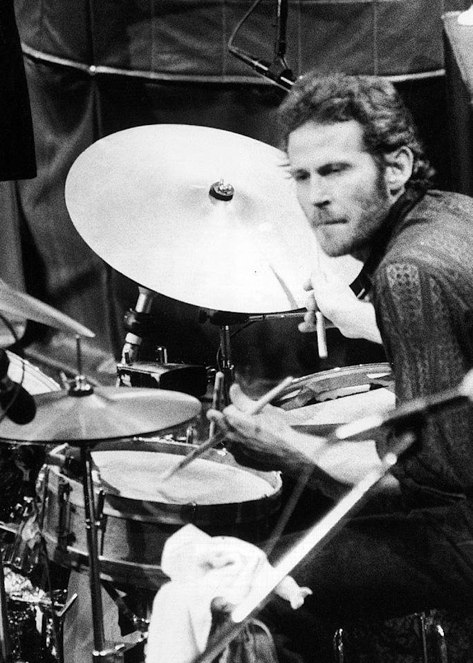 """FILE - In this Nov. 27, 1976 file photo, Levon Helm, of The Band, playes drums at the band's final live performance at Winterland Auditorium in San Francisco. Helm, who was in the final stages of his battle with cancer, died Thursday, April 19, 2012 in New York. He was 71. He was a key member of The Band and lent his distinctive Southern voice to classics like """"The Weight"""" and """"The Night They Drove Old Dixie Down."""" (AP Photo/John Storey, file)"""