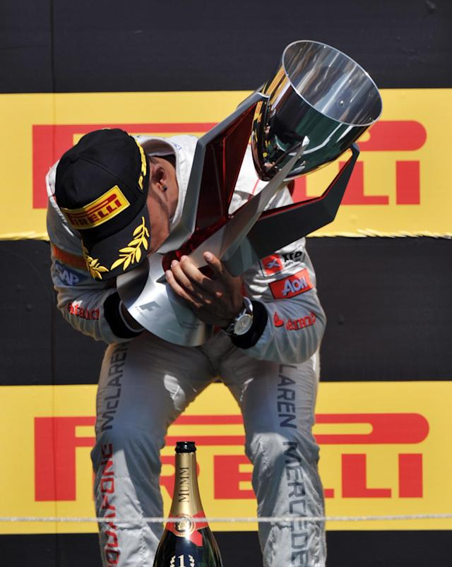 McLaren Mercedes driver Lewis Hamilton of Britain kisses the trophy after winning the Canadian Formula One Grand Prix on June 10, 2012 at the Circuit Gilles Villeneuve in Montreal. AFP PHOTO/Stan HONDASTAN HONDA/AFP/GettyImages