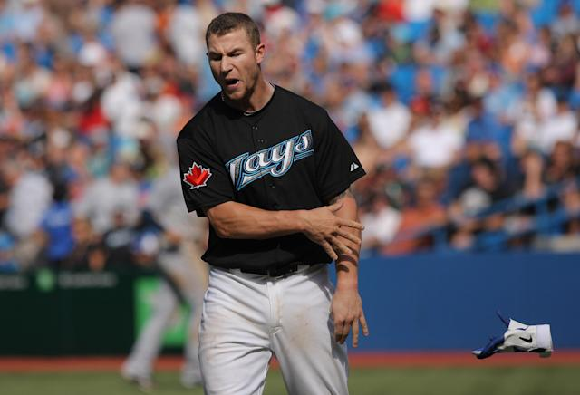 TORONTO, CANADA - AUGUST 27: Brett Lawrie #13 of the Toronto Blue Jays reacts after fouling out to end the 8th inning during MLB game action against the Tampa Bay Rays on August 27, 2011 at Rogers Centre in Toronto, Ontario, Canada. (Photo by Tom Szczerbowski/Getty Images)