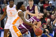 <p>Jordan Bowden #23 of the Tennessee Volunteers collides with Jack Ferguson #13 of the Colgate Raiders in the first round of the 2019 NCAA Men's Basketball Tournament held at Nationwide Arena on March 22, 2019 in Columbus, Ohio. (Photo by Jamie Schwaberow/NCAA Photos via Getty Images) </p>