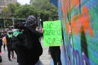 A woman wields a hammer during an abortion-rights demonstrators on the Day for Decriminalization of Abortion, in Mexico City, Tuesday, Sept. 28, 2021. (AP Photo/Ginnette Riquelme)