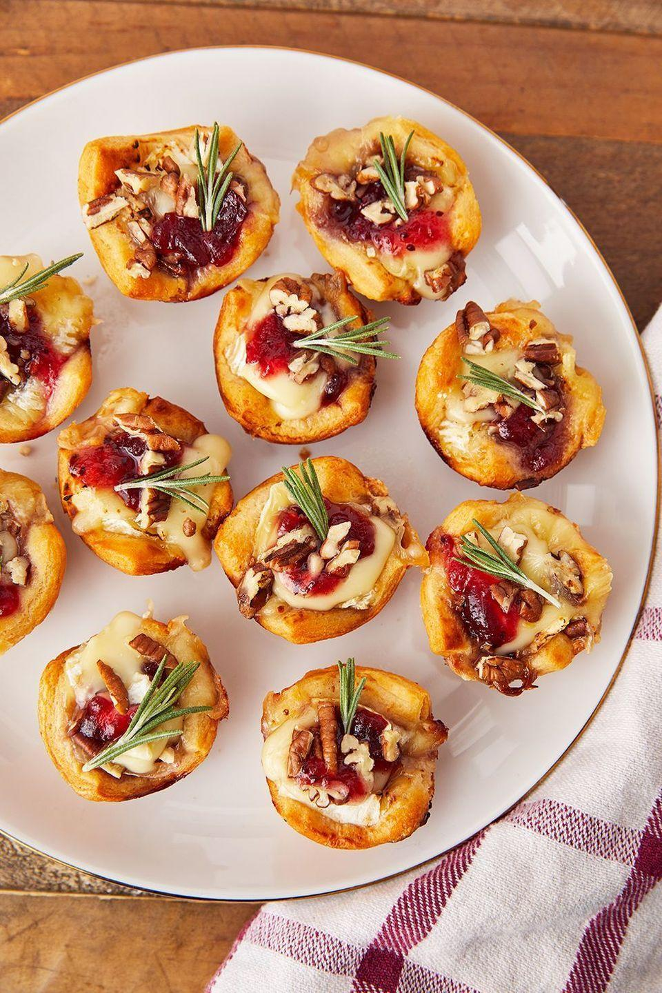 "<p>The perfect party appetizer.</p><p>Get the recipe from <a href=""https://www.delish.com/cooking/recipe-ideas/recipes/a56610/cranberry-brie-bites-recipe/"" rel=""nofollow noopener"" target=""_blank"" data-ylk=""slk:Delish"" class=""link rapid-noclick-resp"">Delish</a>. </p>"