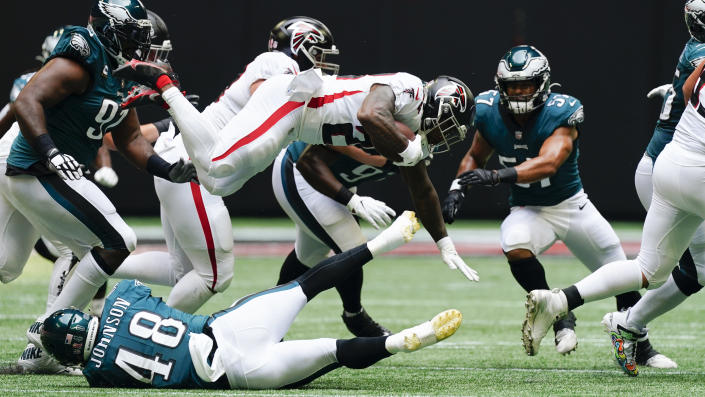 Atlanta Falcons running back Mike Davis (28) leaps in the air against the Philadelphia Eagles during the first half of an NFL football game, Sunday, Sept. 12, 2021, in Atlanta. (AP Photo/John Bazemore)