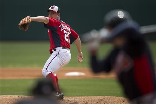 Washington Nationals pitcher Jordan Zimmermann delivers a pitch to Atlanta Braves' Freddie Freeman during the second inning of an exhibition spring training baseball game on Sunday, March 24, 2013, in Viera, Fla. (AP Photo/Evan Vucci)