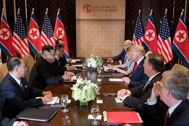 <p>US President Donald Trump (3rd R) and North Korea's leader Kim Jong Un (2nd L) sit down with their respective delegations for the US-North Korea summit, at the Capella Hotel on Sentosa island in Singapore on June 12, 2018. – Donald Trump and Kim Jong Un became on June 12 the first sitting US and North Korean leaders to meet, shake hands and negotiate to end a decades-old nuclear stand-off. (Photo: Saul Loeb/AFP/Getty Images) </p>