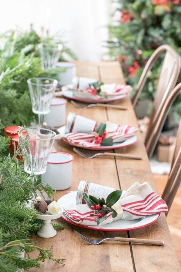 "<p>Attach holly leaves to napkin rings. Add a garland as a runner and you've got a super easy but totally festive table.</p><p>See more at <a href=""https://sugarandcharm.com/2014/12/charming-christmas-brunch.html?section-5"" rel=""nofollow noopener"" target=""_blank"" data-ylk=""slk:Sugar and Charm"" class=""link rapid-noclick-resp"">Sugar and Charm</a>.</p>"