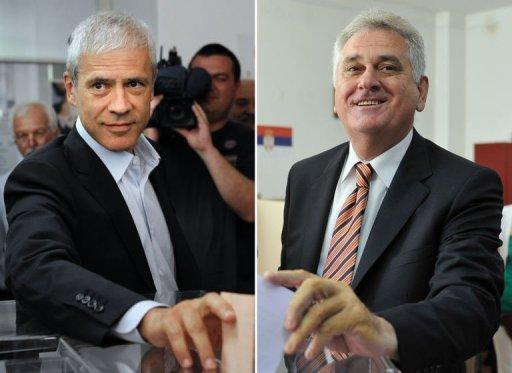 Presidential candidates Tomislav Nikolic (R), leader of Serbian Progressive Party (SNS), and Serbian incumbent President Boris Tadic (L) and leader of the Democratic Party (DS) cast their ballots at polling stations in Belgrade. Tadic and Nikolic will contest the second round of presidential elections, estimates showed Sunday