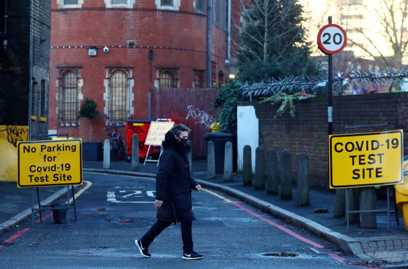 A person walks past the entrance to a testing site, amid the coronavirus disease (COVID-19) pandemic, in London