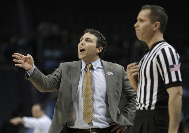 FILE - In this March 12, 2019, file photo, Georgia Tech head coach Josh Pastner, left, directs his team against Notre Dame during the first half of an NCAA college basketball game in the Atlantic Coast Conference tournament, in Charlotte, N.C. Georgia Tech's basketball team was banned from postseason play for the upcoming season and slapped with four years of probation for major recruiting violations committed by a former assistant coach and an ex-friend of head coach Josh Pastner. The sanctions handed down Thursday, Sept. 26, 2019, by the NCAA also included a reduction in scholarships, limits on recruiting and a fine of $5,000 plus 2% of the program's budget. (AP Photo/Nell Redmond, File)