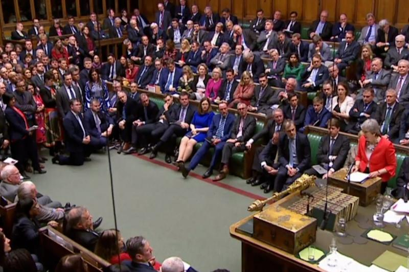 MPs listen to Theresa May's statement after her Brexit plans were defeated for a second time (AFP/Getty Images)
