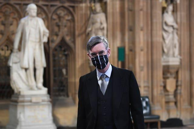 House of Commons Leader Jacob Rees-Mogg wears a mask in Central Lobby