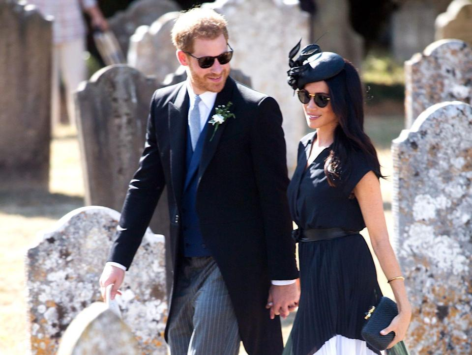 <p>Harry and Meghan arrive at the wedding of Harry's old friend, Charlie Van Straubenzee. </p>