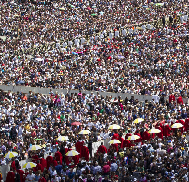 Prelates move on for the Communion rite during a Pentecost mass celebrated by Pope Francis, in St. Peter Square at the Vatican, Sunday, May 19, 2013. (AP Photo/Alessandra Tarantino)