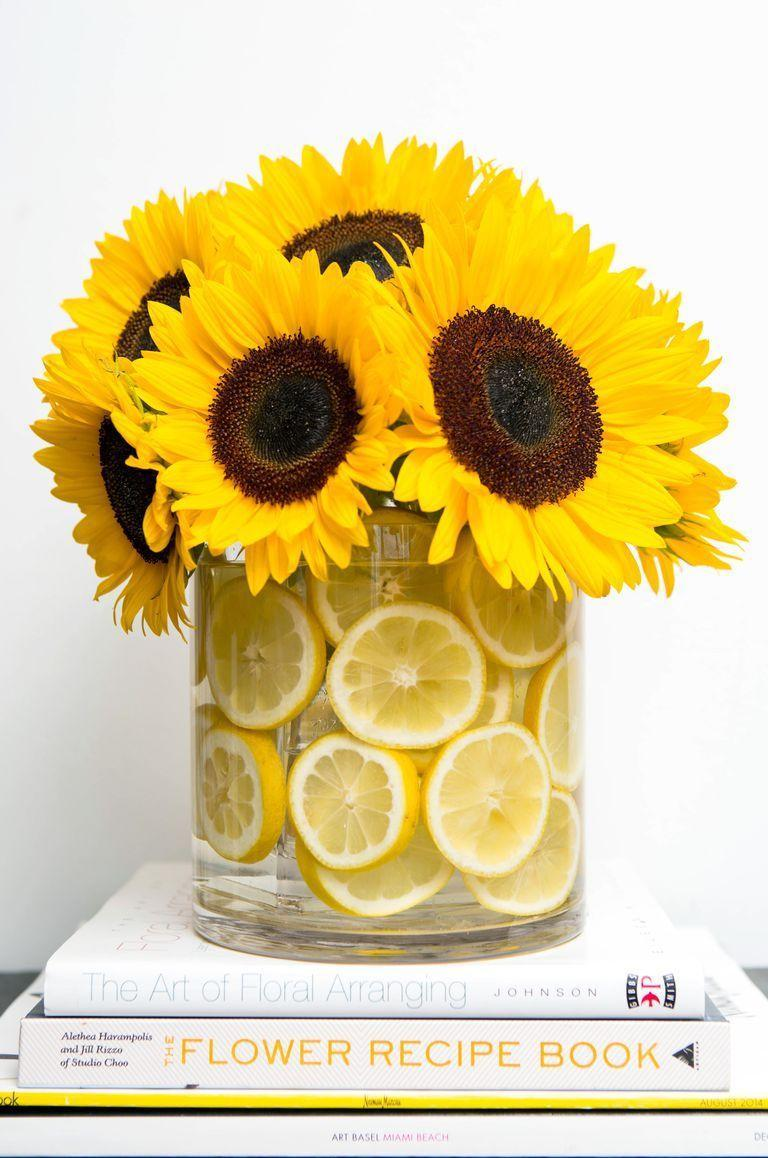 """<p>Yellow on yellow has never looked better than this tangy floral arrangement, complete with fresh lemon slices. </p><p><em><a href=""""https://www.cosmopolitan.com/lifestyle/how-to/a29991/flower-hacks-that-will-blow-your-mind/"""" rel=""""nofollow noopener"""" target=""""_blank"""" data-ylk=""""slk:Get the tutorial from Cosmopolitan »"""" class=""""link rapid-noclick-resp"""">Get the tutorial from Cosmopolitan »</a></em> </p>"""