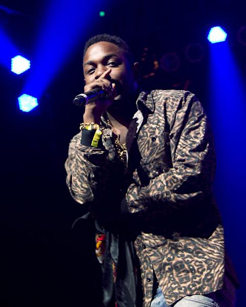 FILE - This June 7, 2012 file photo shows rapper Kendrick Lamar at the Bonnaroo music festival in Manchester, Tenn. Lamar made a splash with his major label release, debuting No. 2 on Billboard's Top 200 behind Taylor Swift, and topped the rap charts with more than 241,000 copies sold. His album also generated 2.8 million streams through Spotify, the second highest first week output so far this year. (AP Photo/Dave Martin, file)