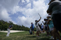 Sergio Garcia, left, of Spain, chips onto the fourth green during the third round of the BMW Championship golf tournament, Saturday, Aug. 28, 2021, at Caves Valley Golf Club in Owings Mills, Md. (AP Photo/Julio Cortez)