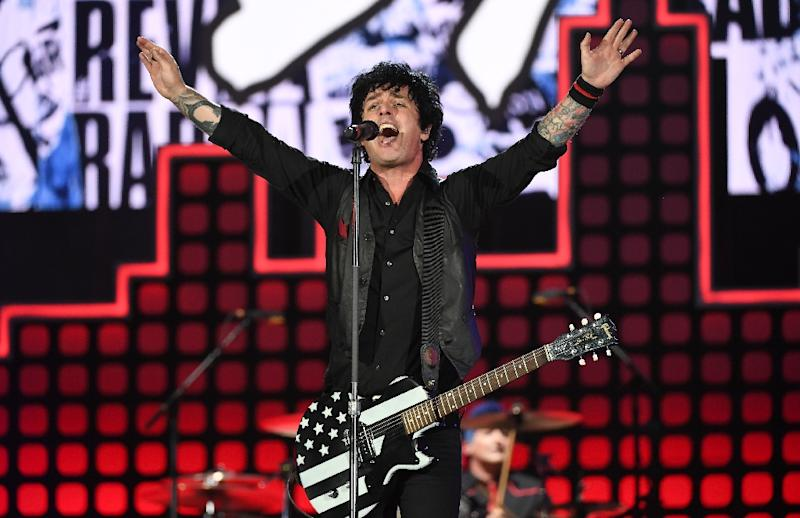 "Punk rock greats Green Day injected politics as well, with frontman Billie Joe Armstrong weaving Trump into the lyrics of ""American Idiot,"" the band's high-octane 2004 indictment of US media culture (AFP Photo/ANGELA WEISS)"