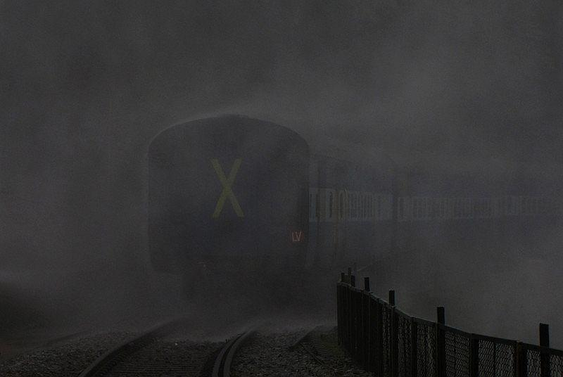 And away she goes into the mist! Huge cheers resound from a rain-darkened train as it passes the waterfalls. What a breathtaking scene!