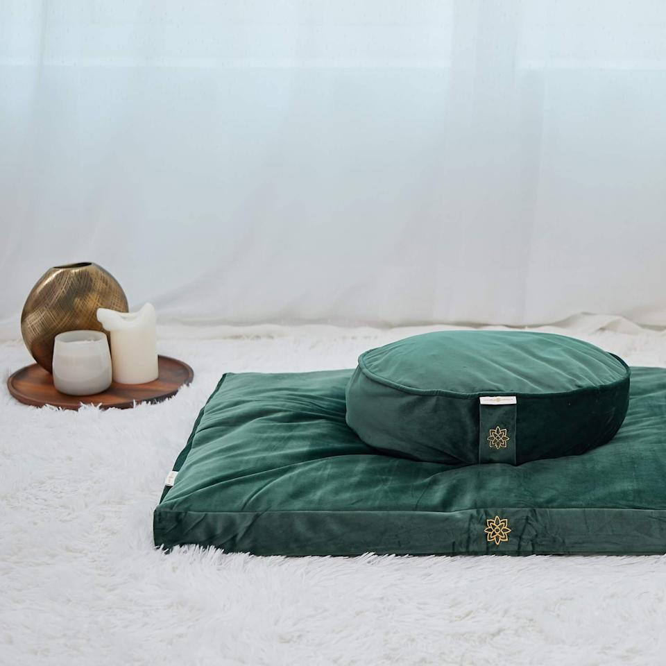 "<h2>Mindful and Modern Luxe Velvet Meditation Pillow Set</h2><br>These luxe meditation cushions are a comfy addition to any practice. ""I got into meditation seriously at the beginning of this year and can't express enough how much this set completes my experience,"" one reviewer wrote. But even if your friend never takes a single belly breath on them, at least they'll look chic in their living room.<br><br><strong>Mindful and Modern</strong> Emerald Green Luxe Velvet Meditation Pillow Set, $, available at <a href=""https://go.skimresources.com/?id=30283X879131&url=https%3A%2F%2Fwww.mindfulandmodern.com%2Fproducts%2Femerald-green-luxe-velvet-meditation-set"" rel=""nofollow noopener"" target=""_blank"" data-ylk=""slk:Mindful and Modern"" class=""link rapid-noclick-resp"">Mindful and Modern</a>"