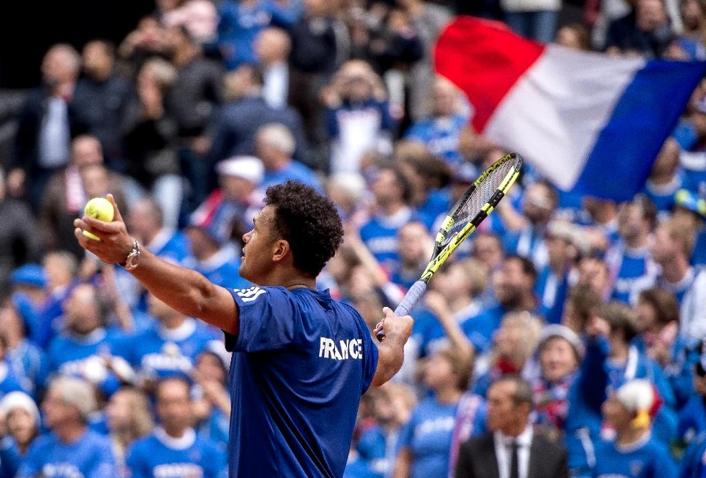 Jo-Wilfried Tsonga celebrates France's Davis Cup World Group semi-final win against Serbia at The Pierre Mauroy Stadium in Lille on September 17, 2017 (AFP Photo/Philippe HUGUEN)