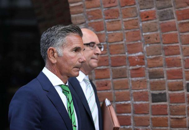 PHOTO: Mossimo Giannulli, left, husband of actress Lori Loughlin, follows her out of the John Joseph Moakley United States Courthouse in Boston on April 3, 2019. (Boston Globe via Getty Images, FILE)