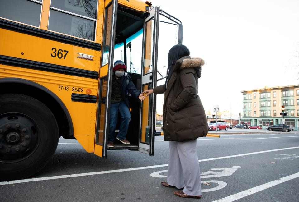 Scott greets Yasin as he gets off the bus after school on Nov. 24. (Photo: Kayana Szymczak for HuffPost)