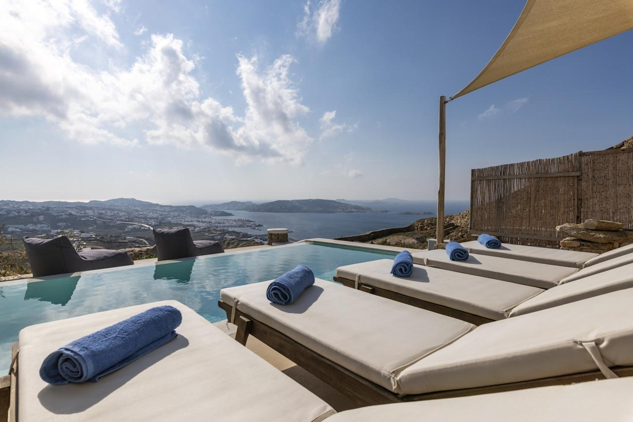 """<p>If you're traveling with a group of pool-lovers who prefer a view of the ocean to the actual sand, this stunning mountaintop home may be just the ticket. That said, it's a 10-minute drive down to the beaches of Mykonos should you want to take a dip in the ocean, too. Beyond the poolside lounge chairs and outdoor dining table, the Airbnb can sleep up to six inside—four on beds (a double and two twins) and two on the sofa bed. It comes with a free parking spot, if you're driving, and fresh towels offered daily.</p> <p><strong>Book now:</strong> <a href=""""https://airbnb.pvxt.net/xaM0O"""" rel=""""nofollow"""" target=""""_blank"""">From $206 per night, airbnb.com</a></p>"""