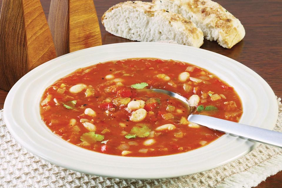 """This take on minestrone uses refried beans as a thickener; the resulting soup is very thick and rich without having to cook all day. <a href=""""https://www.epicurious.com/recipes/food/views/beany-vegetarian-minestrone-soup?mbid=synd_yahoo_rss"""" rel=""""nofollow noopener"""" target=""""_blank"""" data-ylk=""""slk:See recipe."""" class=""""link rapid-noclick-resp"""">See recipe.</a>"""