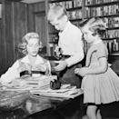 <p>While in the study of her Los Angeles home, Lauren Bacall sorts through papers with her children, Stephen and Leslie. </p>
