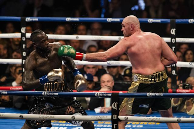 Tyson Fury lands a left hand against Deontay Wilder (Photo by Philip Pacheco/Anadolu Agency/Getty Images)