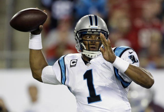 Carolina Panthers quarterback Cam Newton throws a pass against the Tampa Bay Buccaneers during the first half of an NFL football game in Tampa, Fla., Thursday, Oct. 24, 2013. (AP Photo/John Raoux)