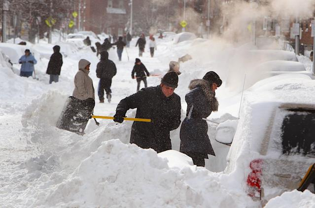 BOSTON - FEBRUARY 9: People begin to dig out from the big blizzard. People dig their cars out on Shawmut Avenue in the South End. (Photo by John Tlumacki/The Boston Globe via Getty Images)