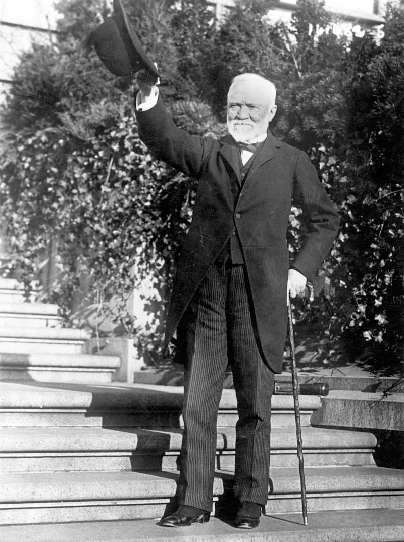 Andrew Carnegie standing on the steps of his estate, circa 1910s. | Corbis