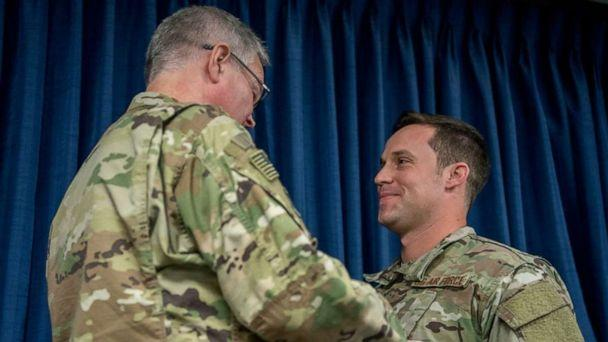 PHOTO: Staff Sgt. Daniel P. Keller (right), receives the Bronze Star Medal from Col. David Mounkes, commander of the 123rd Airlift Wing, at the Kentucky Air National Guard Base in Louisville, Ky., Nov. 17, 2018. (U.S. Air Force)