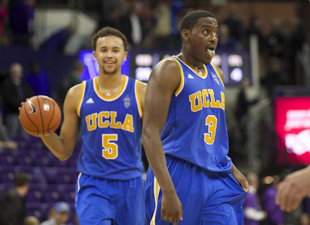 UCLA's Jordan Adams (3) and teammate Kyle Anderson react to defeating Washington in an NCAA college basketball game on Thursday March 6, 2014, in Seattle. UCLA won 91-82. (AP Photo/Stephen Brashear)