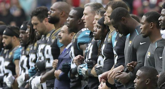 "<p>Ravens owner Steve Bisciotti and Jaguars owner Shad Khan both issued statements on Sunday morning after players on both teams knelt and linked arms while the national anthem was playing before their game at Wembley Stadium in London. Khan, who donated $1 million to President Donald Trump's campaign, stood on the sideline and linked arms [<br><a href=""http://profootballtalk.nbcsports.com/2017/09/24/shad-khan-it-was-a-privilege-to-stand-with-players-on-sunday/"" rel=""nofollow noopener"" target=""_blank"" data-ylk=""slk:more"" class=""link rapid-noclick-resp"">more</a>]<br></p>"