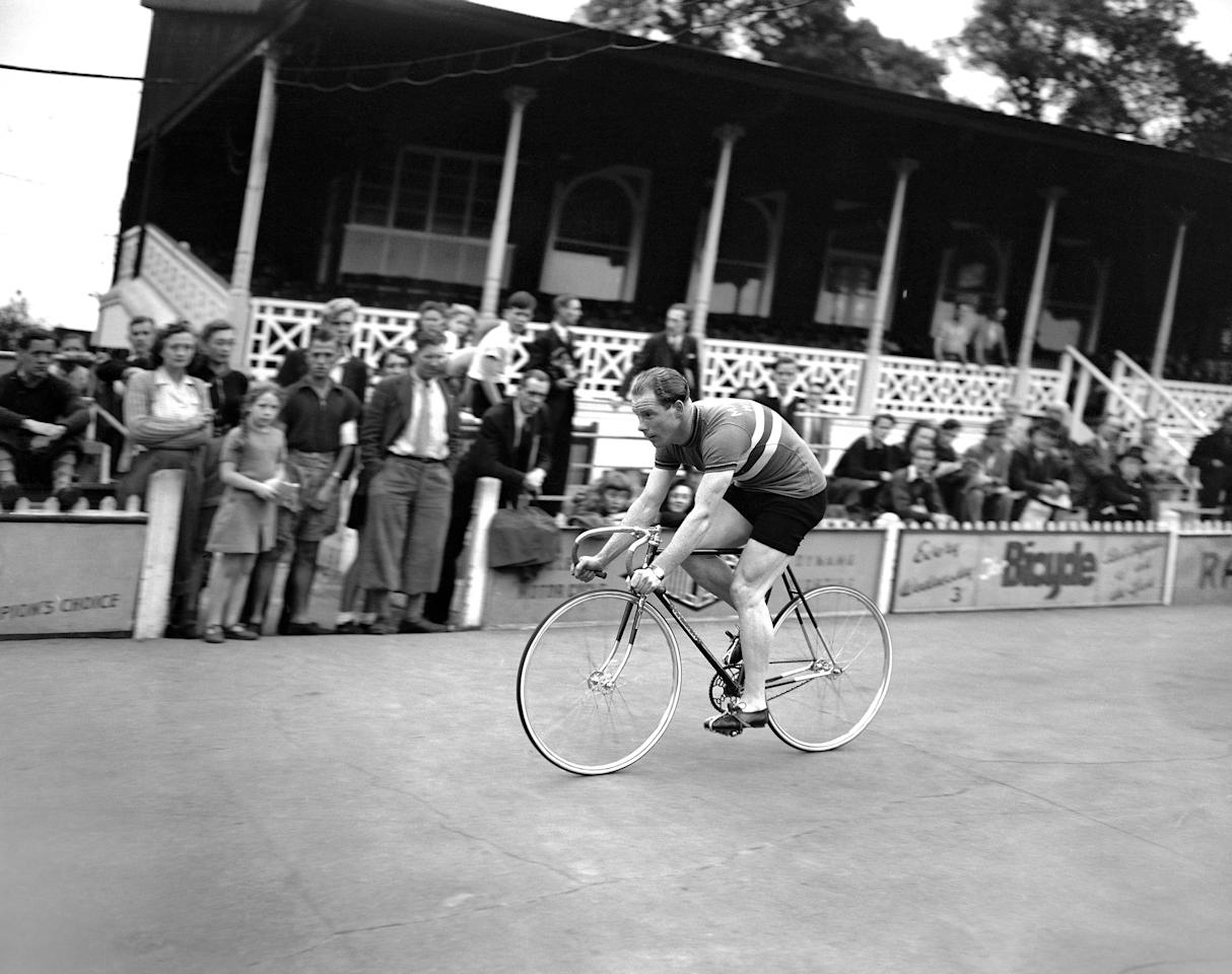Reg Harris, British world amateur sprint cyclist champion, seen on his racing machine, on the Olympic cycling tracks at Herne Hill Velodrome in London, United Kingdom, on August 4, 1948. Harris was later dropped from the British Olympic team by the organizing committee of the national cyclists' union for refusing to train at the Olympic quarters. He complained of conditions at the camp and returned to his home in Manchester. He stated that he had been invited to attend a meeting of the national cyclists' union committee to explain his case at night. (AP Photo/John Rider-Rider)