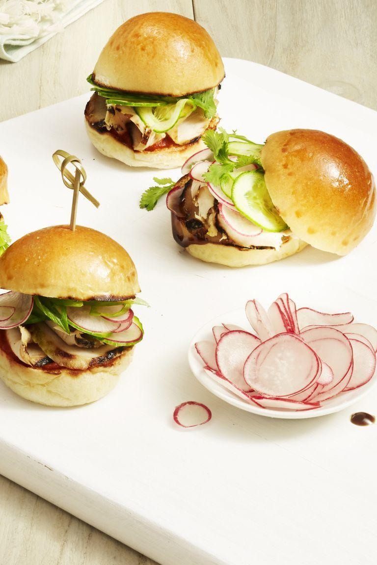 """<p>If a big ol' burger is too much for you to handle between meetings, munch on these smaller — yet filling — sliders, garnished with radishes and cucumbers. </p><p><em><a href=""""https://www.goodhousekeeping.com/food-recipes/easy/a22576918/grilled-chicken-sliders-recipe/"""" rel=""""nofollow noopener"""" target=""""_blank"""" data-ylk=""""slk:Get the recipe for Grilled Chicken Sliders »"""" class=""""link rapid-noclick-resp"""">Get the recipe for Grilled Chicken Sliders »</a></em></p><p><strong>RELATED:</strong> <a href=""""https://www.goodhousekeeping.com/food-recipes/g1553/burger-recipes/"""" rel=""""nofollow noopener"""" target=""""_blank"""" data-ylk=""""slk:30+ Burger Recipes You Need to Try ASAP"""" class=""""link rapid-noclick-resp"""">30+ Burger Recipes You Need to Try ASAP</a></p>"""