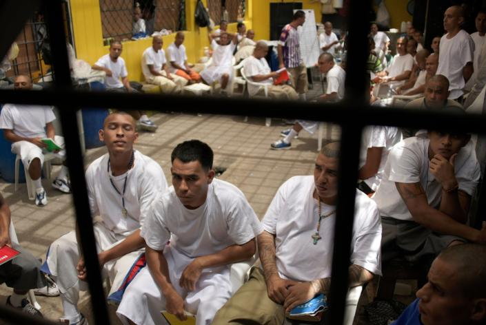 "<span class=""caption"">No chance of social distancing in El Salvador's prisons.</span> <span class=""attribution""><a class=""link rapid-noclick-resp"" href=""https://www.gettyimages.com/detail/news-photo/members-of-the-ms-13-gang-remain-in-chalatenango-prison-84-news-photo/1137660936?adppopup=true"" rel=""nofollow noopener"" target=""_blank"" data-ylk=""slk:Marvin Recinos/AFP via Getty Images"">Marvin Recinos/AFP via Getty Images</a></span>"